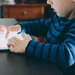 Image of a child on a mobile tablet