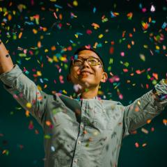 Image of man celebrating with confetti